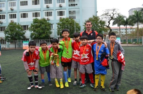 U11 Champions - SIS Ciputra Reds with Coach John Shoulders